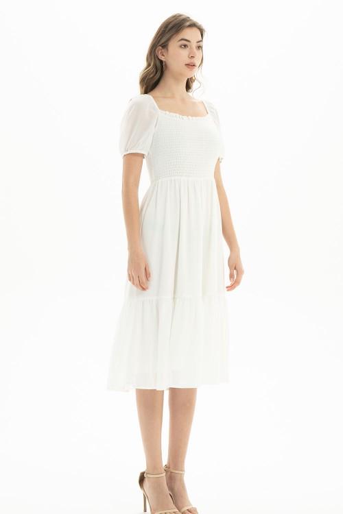 فستان نسائي لون ابيض مطفي
