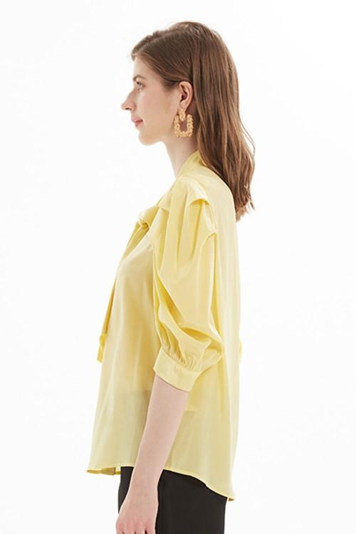 بلوزة نسائي لون اصفر